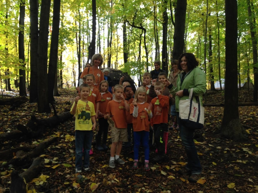 Pictured here on one of Blandford Nature Center's trails is a group of students and teachers from Alllendale Christian Elementary School with a Blandford volunteer as their guide.  Last year nine thousand school children toured the Center's 143 acres of woods inside the city of Grand Rapids.
