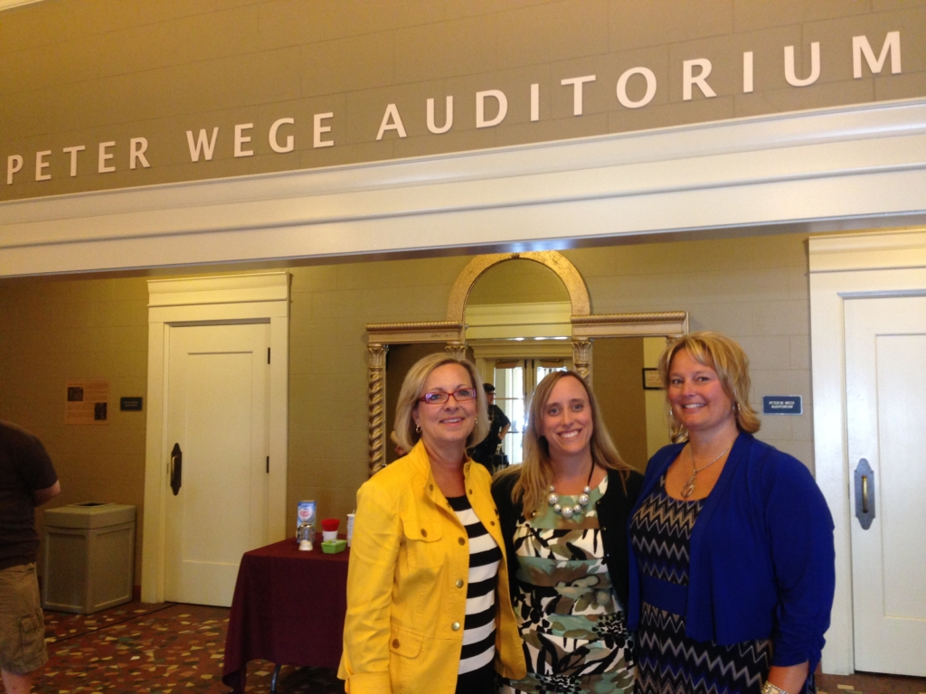 Ellen Satterlee, CEO of The Wege Foundation, Katy Furtado, Administrative Assistant, and CFO Jody Price honoring the name above them and celebrating The Foundation's gift of LED lighting to Wealthy Theatre.